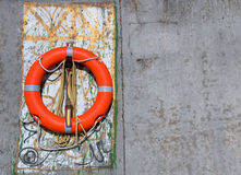 Lifesaver Hanging on Concrete Wall Royalty Free Stock Images