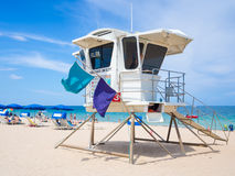 Lifesaver hut and people enjoying the beach at Fort Lauderdale Royalty Free Stock Image