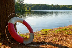 Lifesaver at a Lake. Lifesaver in the Nature on a Lake with green Trees around, summer Stock Photos