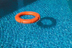 Lifesaver (Life Buoy) belt in water. A life preserver in open blue water stock images