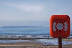 Lifesaver na costa Imagens de Stock Royalty Free