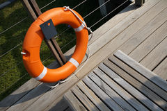 Lifesaver next to a bench. Lifesaver ready to be used in case of emergencies Stock Photos