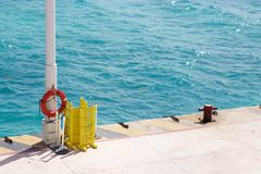 Lifesaver on pole on ferry dock, Playa del Carmen, Mexico Stock Photos