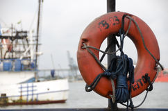 Lifesaver with ships in the background Royalty Free Stock Photo