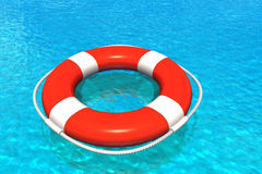 Lifesaver in water. Red lifesaver belt in the pool with blue water Stock Photos