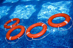 Lifesavers. A view of orange lifesavers in the pool Royalty Free Stock Photo