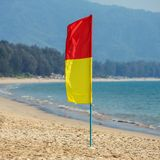 Lifesavers patrol red and yellow flag Stock Photos