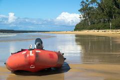 Lifesaving boat on Beach. Red inflated life saving boat on Mollymook Beach Stock Images