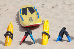Lifesaving equipment lying on the beach sand Royalty Free Stock Photos