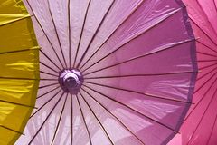 Lifesize colorful cocktail umbrellas, illuminated. stock photo