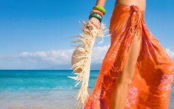 Lifestyle. Closeup of woman wearing sarong holding straw hat Stock Photos