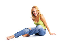 Lifestyle. Happy young woman sitting on the floor Stock Photos