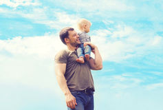 Lifestyle atmospheric photo happy father and son outdoors Stock Photos