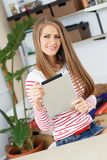 Lifestyle. Attractive girl with tablet Stock Image
