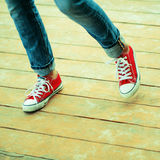 Lifestyle background. Woman dancing on a wooden platform Royalty Free Stock Photography