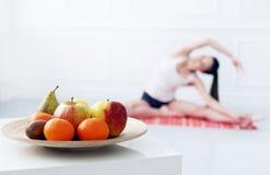 Lifestyle. Beautiful girl during yoga exercise Royalty Free Stock Image