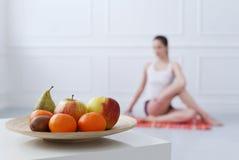 Lifestyle. Beautiful girl during yoga exercise Stock Photos