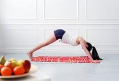 Lifestyle. Beautiful girl during yoga exercise Royalty Free Stock Images