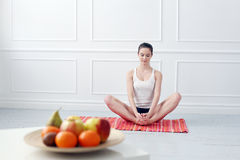 Lifestyle. Beautiful girl during yoga exercise Stock Photography