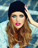 Lifestyle blond model girl in casual cloth with pink lips Royalty Free Stock Image