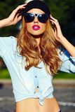 Lifestyle blond model girl in casual cloth with pink lips Stock Image
