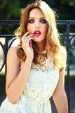 Lifestyle blond model girl in white dress cloth with pink lips Royalty Free Stock Photo