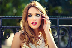 Lifestyle blond model girl in white dress cloth with pink lips Royalty Free Stock Photography