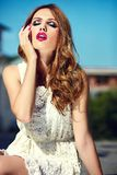 Lifestyle blond model girl in white dress cloth with pink lips Royalty Free Stock Images