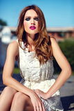 Lifestyle blond model girl in white dress cloth with pink lips Royalty Free Stock Image