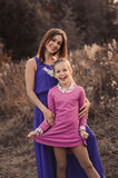 Lifestyle capture of happy mother and preteen daughter having fun outdoor. Loving family spending time together on the walk. royalty free stock photography