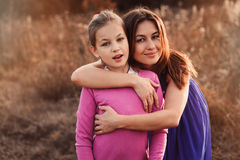 Lifestyle capture of happy mother and preteen daughter having fun outdoor. Loving family spending time together on the walk. royalty free stock images