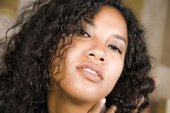Lifestyle close up head portrait of young beautiful and mixed ethnicity latin and African American woman with gorgeous curly royalty free stock photography