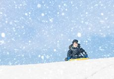 Sledding at winter time Royalty Free Stock Images