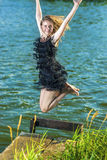 Lifestyle Concept and Ideas: Blond Woman in Dress Jumping N Royalty Free Stock Image