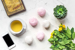 Lifestyle concept with tea and roses on home desk top view Stock Images