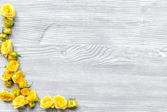 Lifestyle concept with yellow roses on woman table background top view mock-up Stock Photography