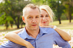 Lifestyle couple portrait in park Royalty Free Stock Image