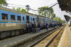 Lifestyle of diverse people travel with Rail transport. BANGKOK THAILAND - 10 Feb 2018 : Diesel railcar at junction Bang Sue train station and Lifestyle of Royalty Free Stock Photos