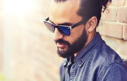 Man with beard on city street. Lifestyle, emotion, expression and people concept - man with beard and sunglasses on city street Stock Photography