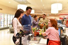 Lifestyle eople shopping for food in the supermarket. Checkout - closeup royalty free stock photo