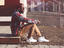 Lifestyle fashion portrait of stylish young african man Royalty Free Stock Photos