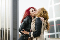 Lifestyle fashion portrait of two pretty cheerful girls friends. stock images