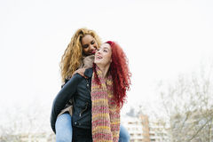 Lifestyle fashion portrait of two pretty cheerful girls friends. Royalty Free Stock Photo