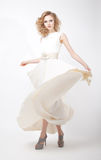 Lifestyle - fashionable young female in dress royalty free stock photography