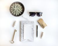 Lifestyle flat lay with accessories. White and gold royalty free stock photos