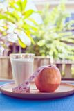 Lifestyle food healthy eating,tape measure,milk and apple Stock Image