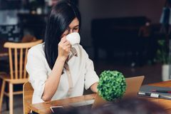 Lifestyle freelance working woman with laptop computer, he drink stock photos