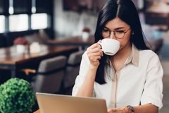Lifestyle freelance working woman with laptop computer, he drink royalty free stock image