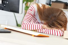 Lifestyle. Girl sleep at work Royalty Free Stock Image