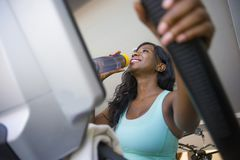 Lifestyle gym portrait of young attractive and happy black African American woman training at fitness club smiling cheerful and sw royalty free stock photo